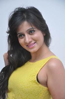 Actress Harshika Poonacha Stills in Yellow Short Dress at Appudala Ippudila Movie Promotions 0004