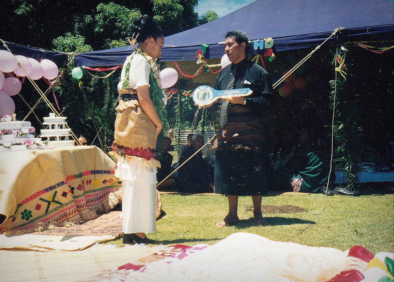 At this Tongan feast, the father gifts his daughter a symbolic key