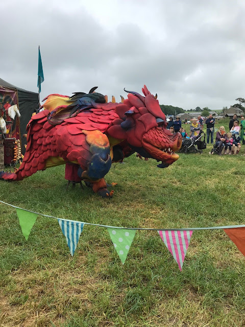 A large dragon puppet