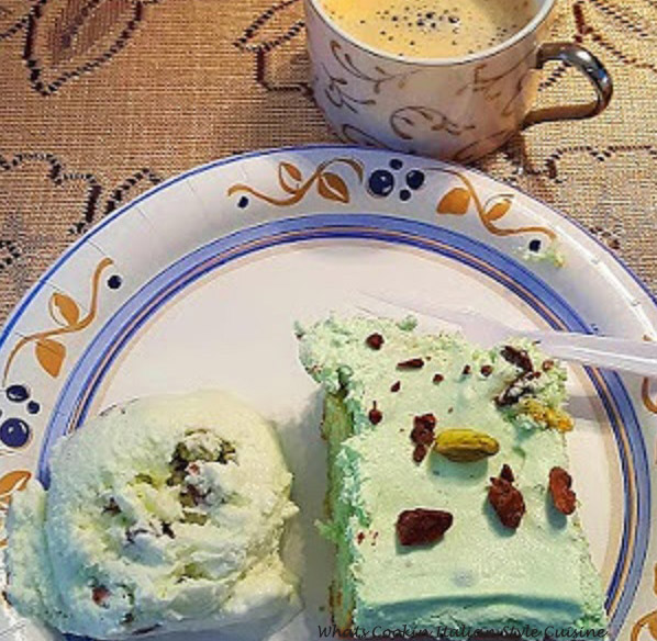 this is a pistachio cake using a cake mix and pudding in the mixture with a pistachio whipped cream and garnished with pistachios and shaved chocolate