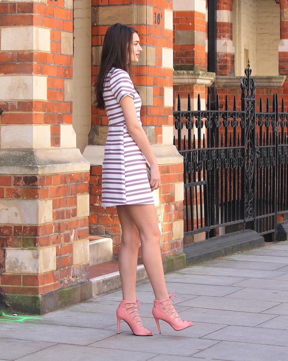 peexo fashion blogger wearing pink striped shift dress for wedding season spring