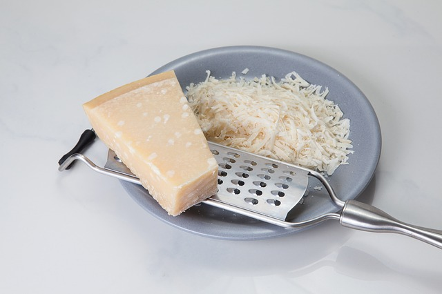 Grated Parmesan Cheese, Grater, and Un-grated Parmesan