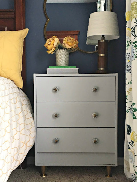 IKEA rast hack as night table with paint, anthropology knobs, gold feet