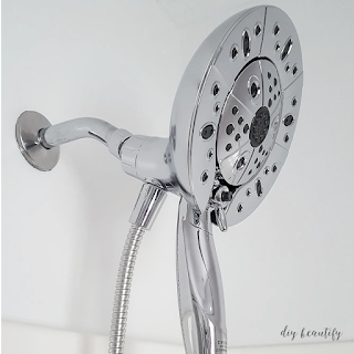 If you've got 5 minutes, you have enough time to swap out your old showerhead for a new one, like this Delta In2ition Showerhead with H2OKinetic Technology that we used! Come on by and see the easy tutorial for making the swap at diy beautify!