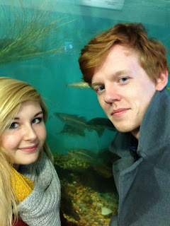 a selfie inside the Mevagissey aquarium. Fish can be seen swimming in the tank behind