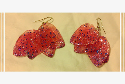 Red with blue sparkle dangle guitar pick earrings