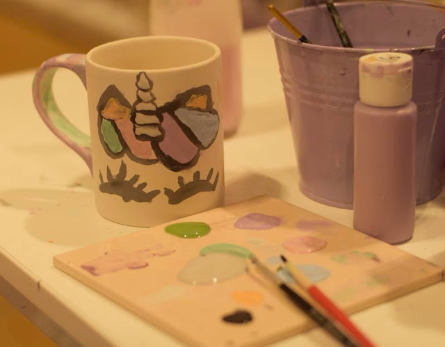 Unicorn mug painted by child at Emily's Paint a Pot in Next, Manchester Arndale