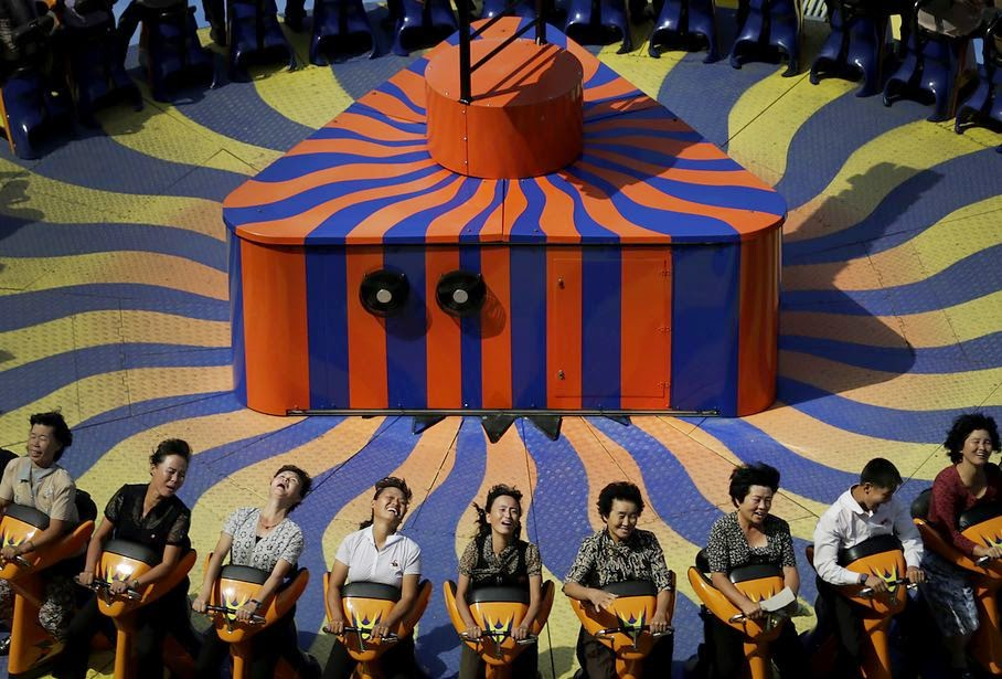 North Koreans enjoy a ride at the Kaeson Youth Amusement Park, Wednesday, Sept. 3, 2014 in Pyongyang, North Korea.