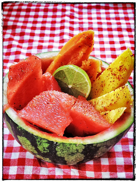 tropical fruit with chilli and lime in a watermelon bowl