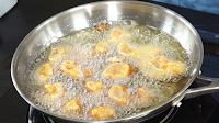 Frying-the-chicken-for-making-chilli-chicken