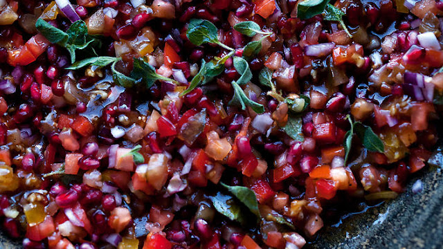 I rarely rave about my own recipes but this is one I can just go on and on about Tomato and pomegranate salad recipe