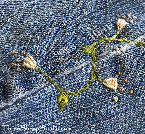 Hand embroidered flowers and vine on jeans, by Rose Clay at ThreeSheepStudio.com