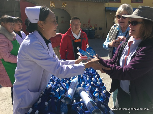 nurse dispenses oxygen water on the way to Jiuzhaigou Valley in Sichuan Province of China