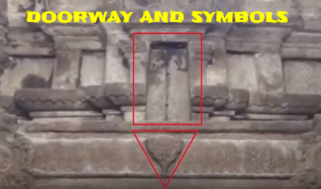 The carved symbol and the doorway above the doors at the Temple in India.
