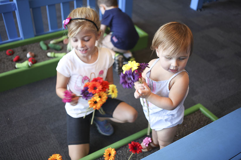 Sisters practice gardening at Glazer Children's Museum in Tampa