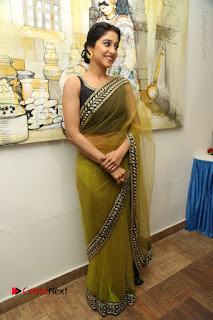 Actress Regina Stills in Green Saree at Vivaha Bhojanambu Restaurant Launch  0176.JPG