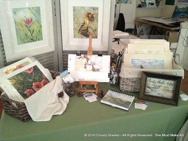 Giclee art prints, framed originals, a work in progress, my sketch book, and originals with mats.