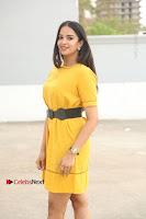 Actress Poojitha Stills in Yellow Short Dress at Darshakudu Movie Teaser Launch .COM 0052.JPG