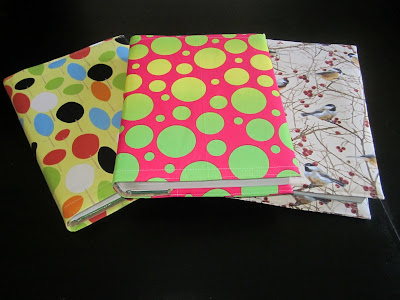 http://sotakhandmade.blogspot.com/2011/08/fabric-textbook-cover-tutorial.html