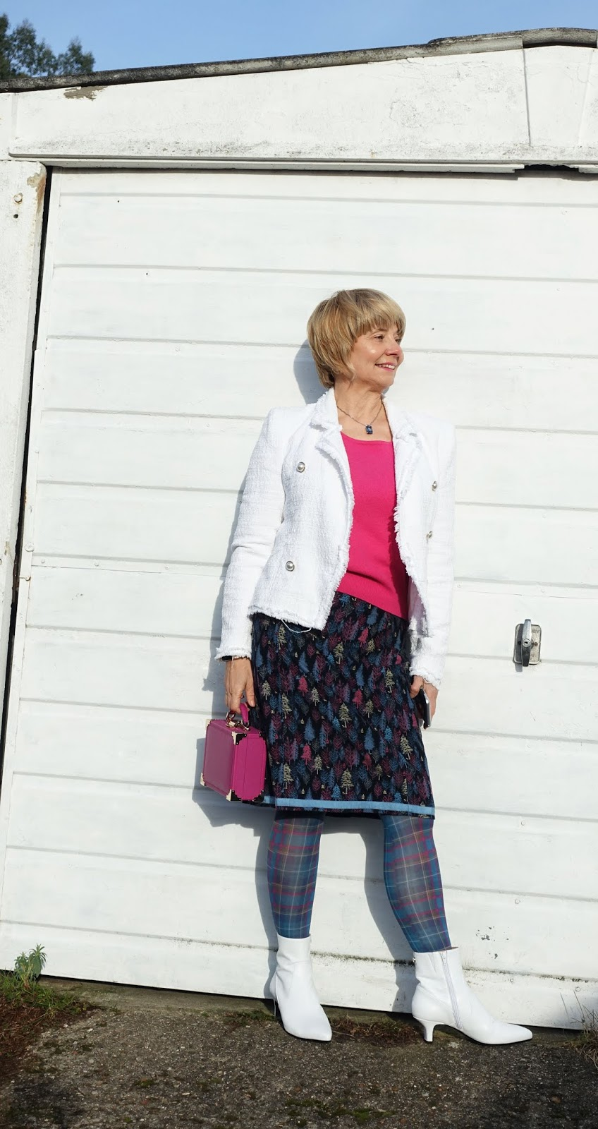 Is This Mutton blogger Gail Hanlon in tartan tights, white ankle boots and pink / blue toned skirt with pink bag