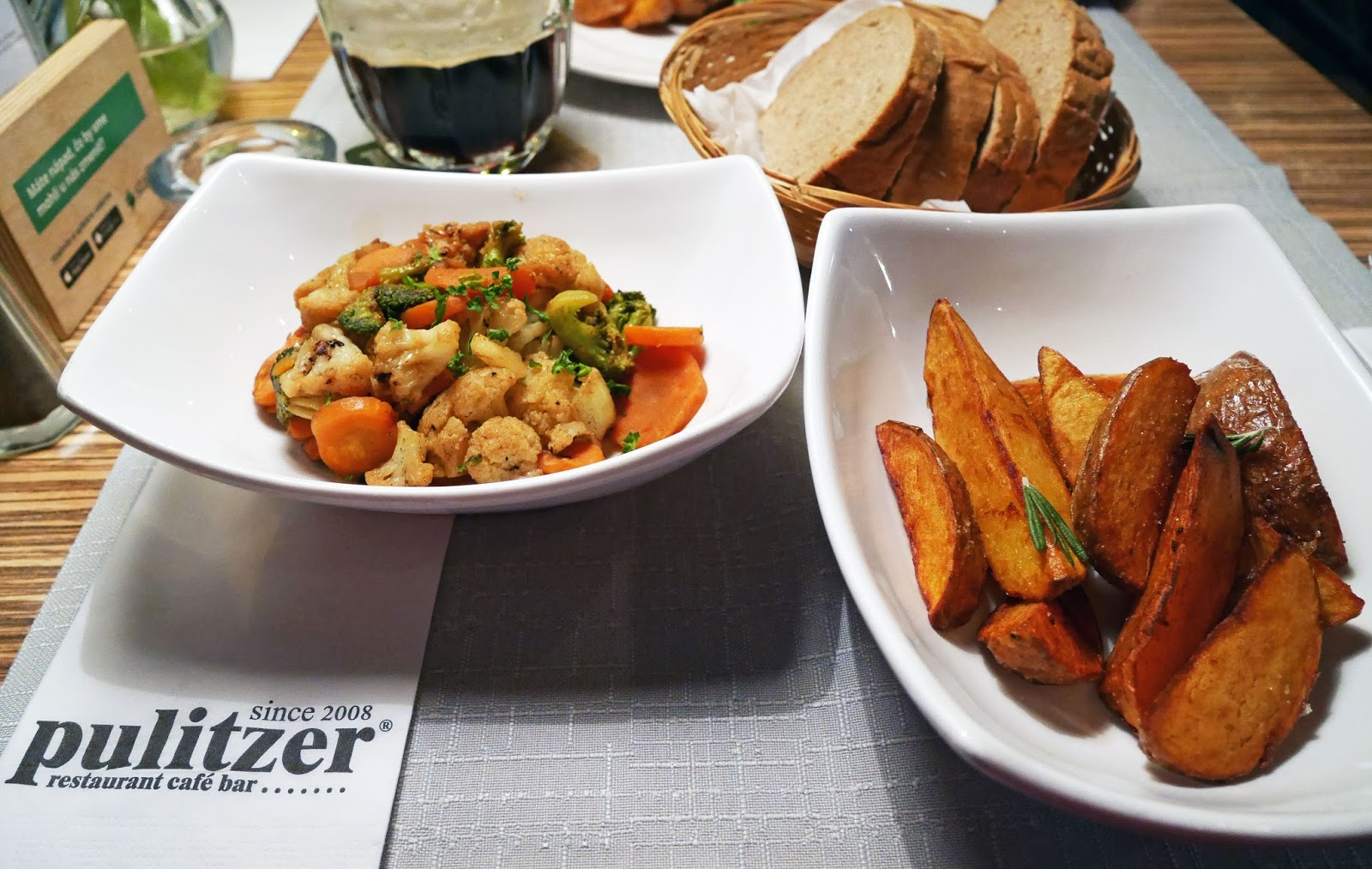 Mixed vegetables, spiced potato wedges and bread at Pulitzer: a lovely restaurant on the edge of Bratislava's Old Town