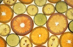 citrus fruit slices on a light table, USDA