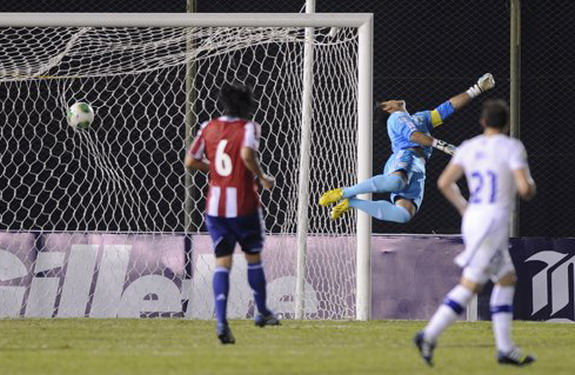 Paraguay goalkeeper Justo Villar fails to stop a goal by Chile player Eduardo Vargas