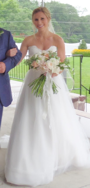 bride with pink and white bouquet