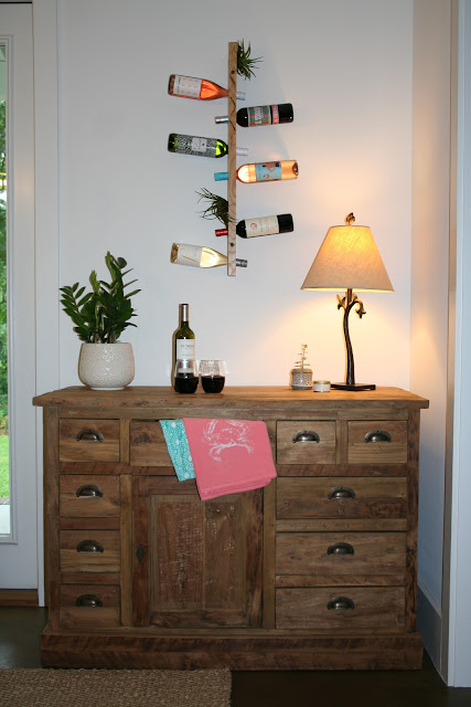 Buffet and vertical floating wine bottle holder with air plants | The Lowcountry Lady