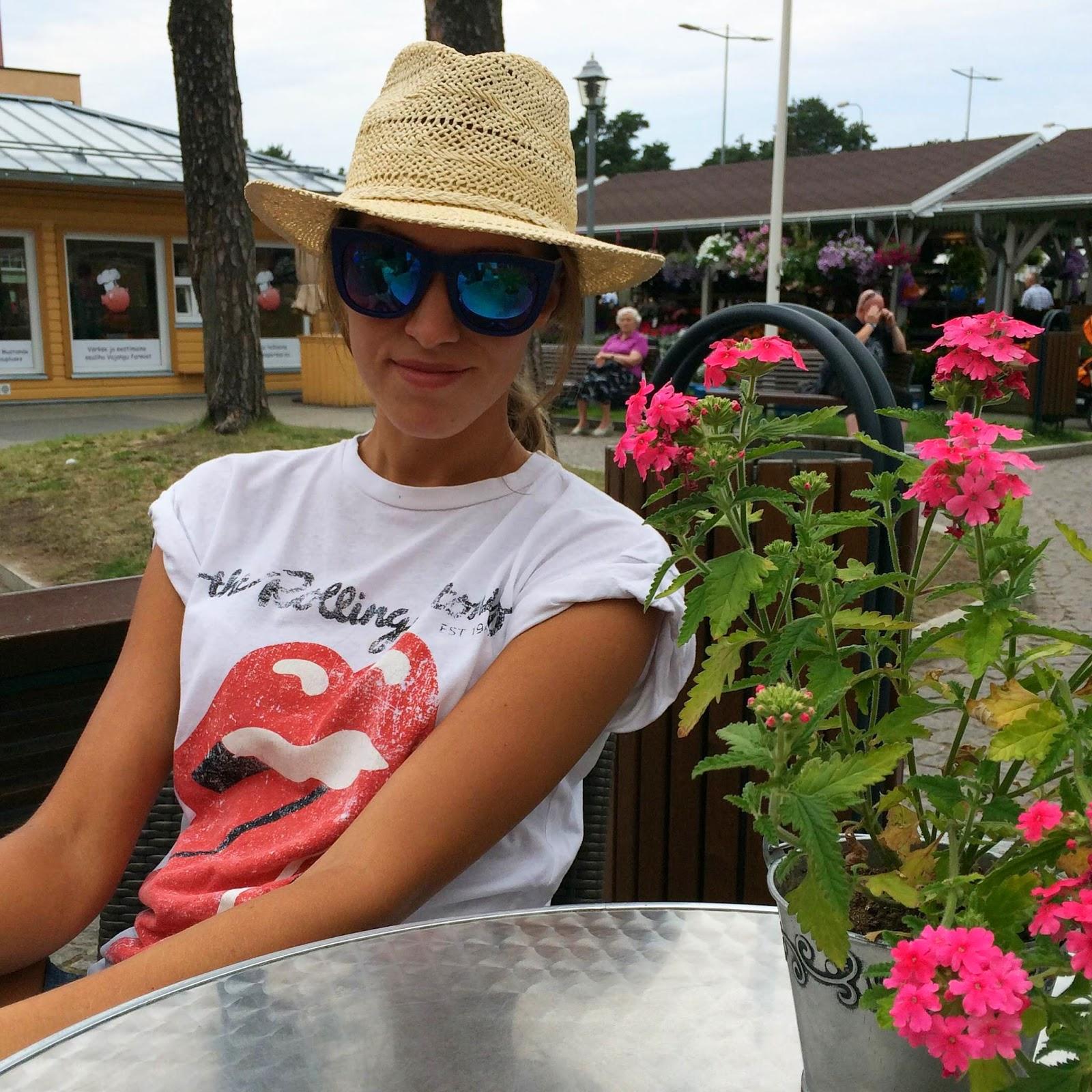 straw hat mirrored sunglasses rolling stones shirt