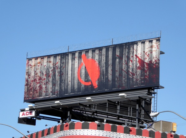 Containment barbed wire teaser billboard