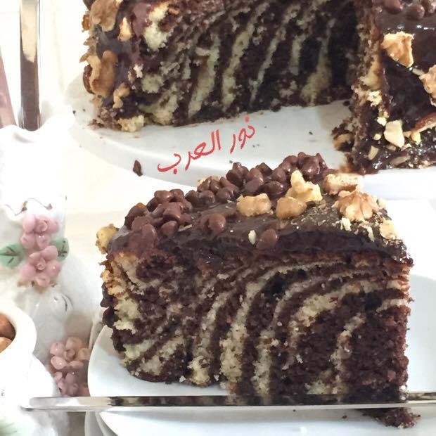 772ba9228cd2a طريقة عمل كيكة الزيبرا الكيك المخطط او كيكة الحليب والشوكولاته