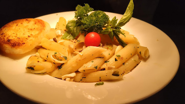 Healthy penne pasta with garlic bread , Mediterranean diet