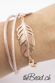 https://www.thebead.ch/product_info.php?info=p428_lederarmband-ros---feder.html