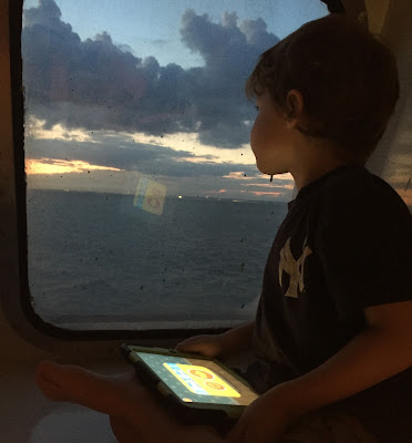 Autitsic boy on ferry boat