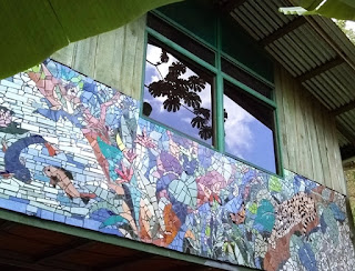 4 mosaics adorn the outside walls of the costa rica cabin