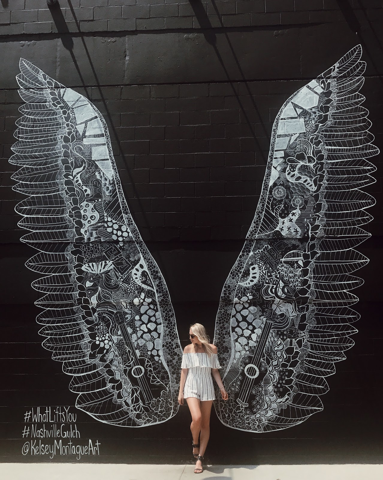 What Lifts You angel wing mural in Nashville