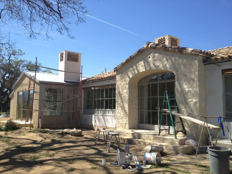 French farmhouse with limestone exterior under construction - found on Hello Lovely Studio