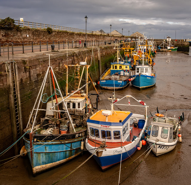Photo of more boats in Maryport Harbour at low tide