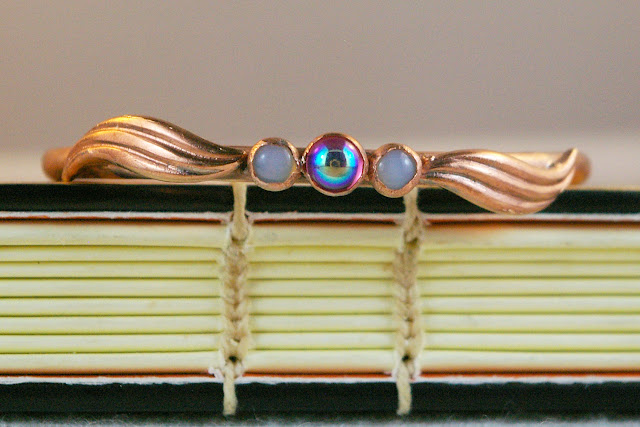 https://www.etsy.com/ca/listing/686177339/copper-and-ab-glass-oval-bangle-vintage