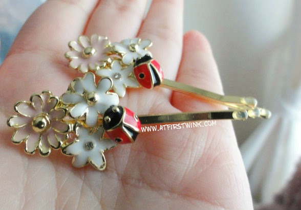 New Look hair pins with flowers and ladybird