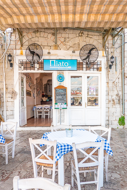 cafe in front of the clock tower Hydra Greece