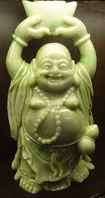 Great light green Buddha jade carving standing