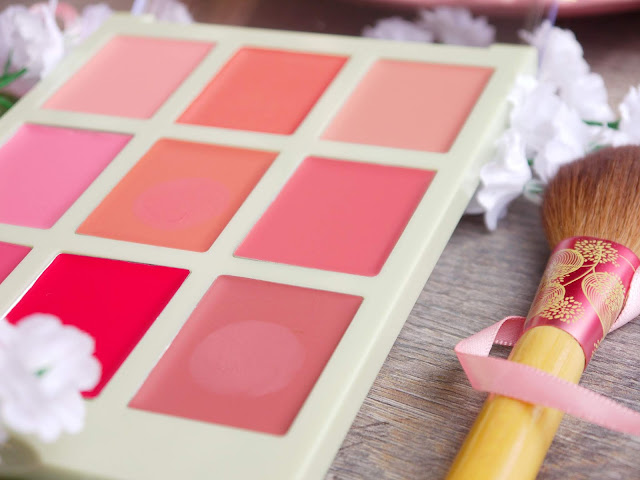 a pale green rectangular palette with 9 pans of cream colour in various shades of peach and pink