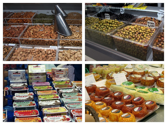 frutos secos, latas de conservas, queijos e azeironas expostos no Mercado Temporário do Bolhão