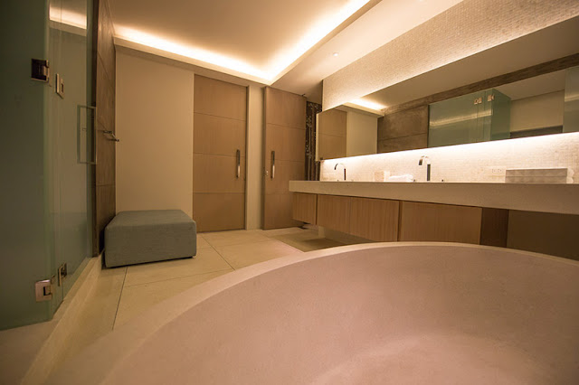 Picture of large modern bathroom at night
