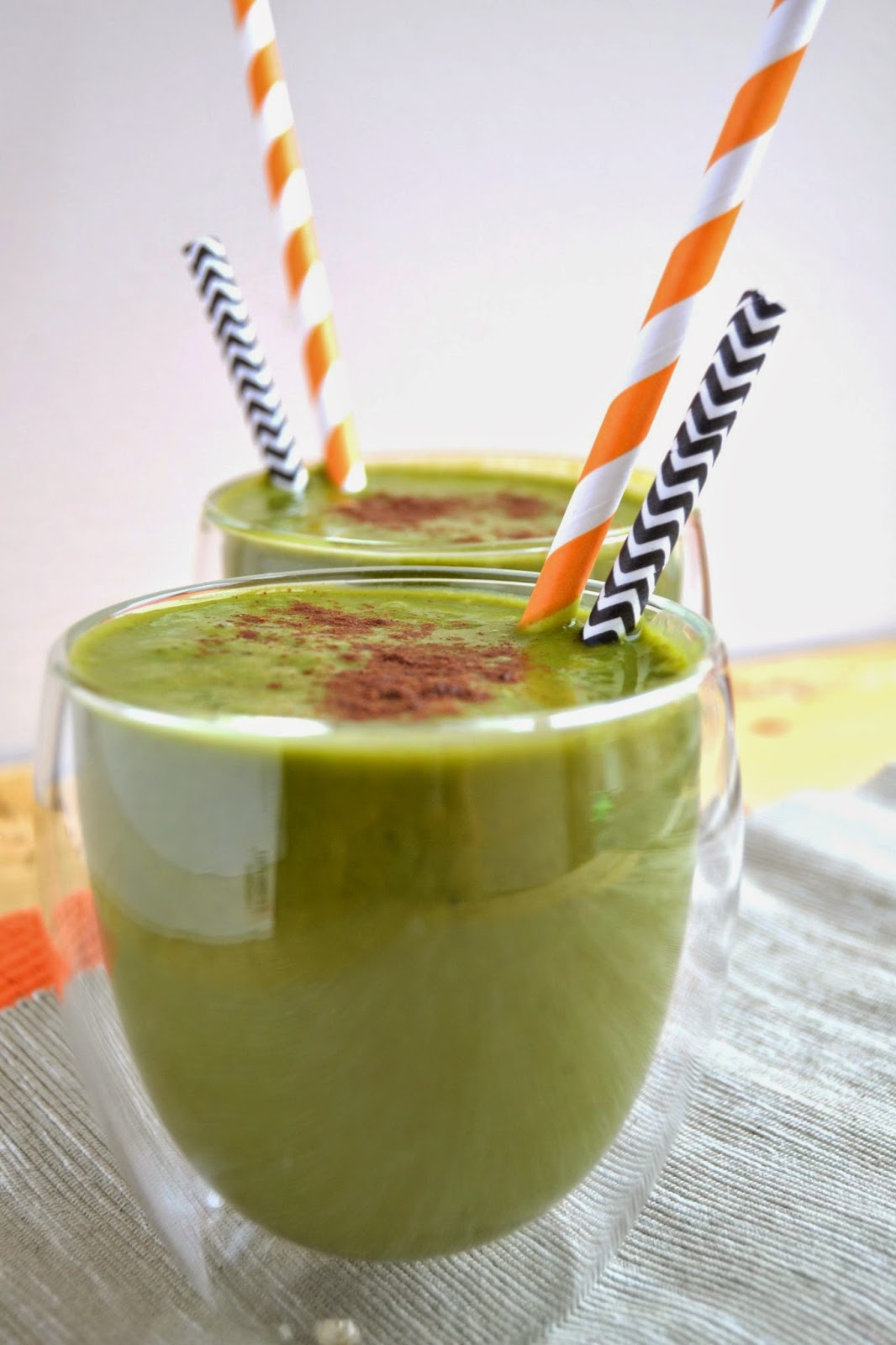 smoothie with spinach, oat milk, pumpkin puree, banana and pumpkin spices