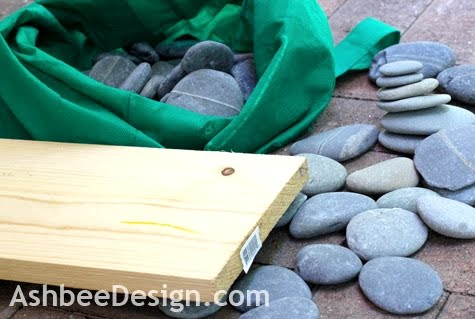 make beach centerpiece with board and rocks