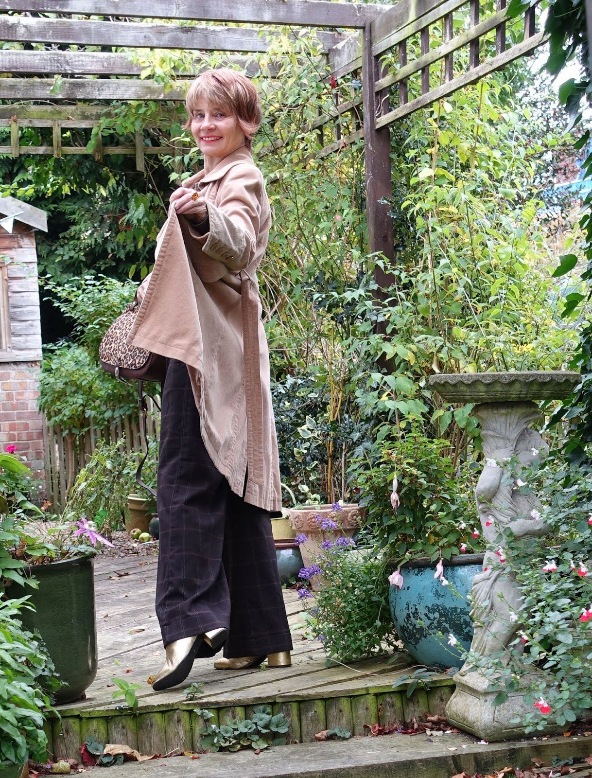 Image showing Is This Mutton blogger Gail Hanlon in thrifted corduroy coat and leopard print bag