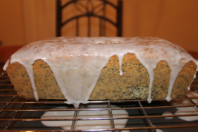 Frosted Lemon Poppyseed Pound Cake On A Cooling Tray